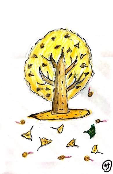 落ち葉舞う銀杏の木