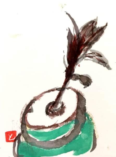緑の鉢に飢えられた草花