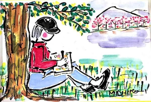 木陰で絵を描く女性の風景