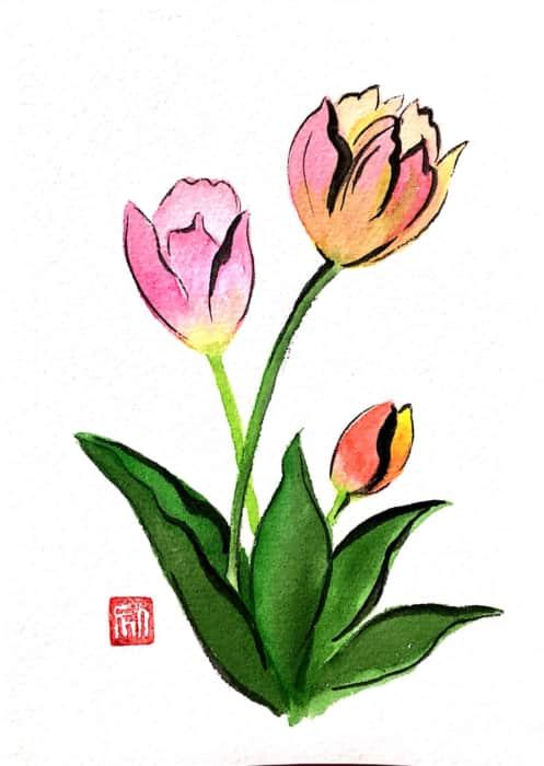 春を寿ぐ赤とピンクのチューリップの花