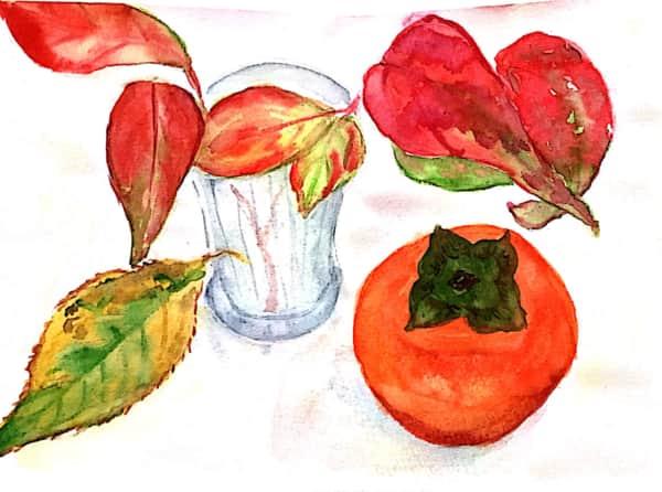 柿の実と紅葉した落ち葉