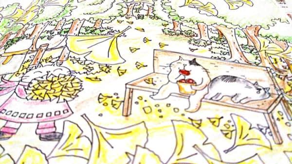 イチョウの葉舞う公園にいる猫の塗り絵
