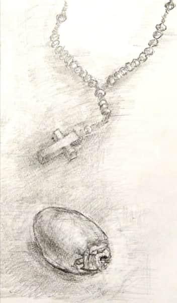 十字架のペンダントと柿の実のデッサン